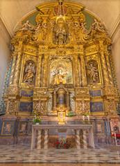 PALMA DE MALLORCA, SPAIN - JANUARY 29, 2019: The baroque main altar with the statue of St. Teresa of Avila in the church Iglesia de Santa Maria Magdalena.