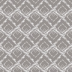 Seamless geometric pattern with white rhombuses on a gray background.