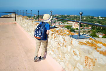 """Little tourist looking down from walls of medieval Chlemoutsi (""""Clermont"""") castle in Greece, Peloponnese, Kyllini-Andravida"""