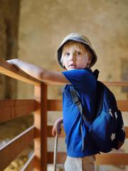 "Little boy in medieval Chlemoutsi (""Clermont"") castle in Greece, Peloponnese, Kyllini-Andravida"
