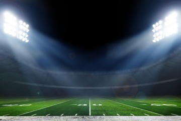 In de dag Cultuur American football stadium with bright lights
