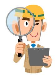 確認及び調査する建築作業員の男性