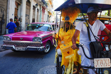 Cherice Harrison-Nelson of the U.S. sits in the back of a bicitaxi as Cuban and New Orleans musicians parade in downtown Havana