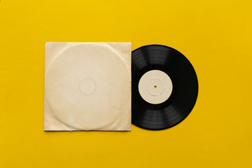Fototapeta the mockup template with the new vinyl disc on color surface, music album cover design obraz
