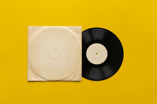 the mockup template with the new vinyl disc on color surface, music album cover design