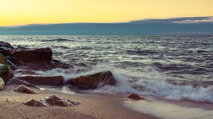 Wave crashing on the rocky seashore