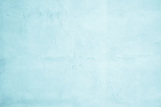 Pastel Blue and White concrete stone texture for background in summer wallpaper. Cement and sand wall of tone vintage. Concrete abstract wall of light blue color, cement texture background for design.
