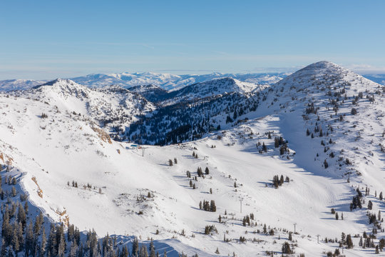 Panoramic view of mountains and skyline from Hidden Peak at Snowbird in Little Cottonwood Canyon in the Wasatch Range near Salt Lake City, Utah, USA.