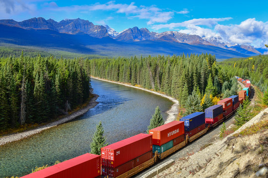 ALBERTA, CANADA - October 1,2017: freight train moving along Bow river in Canadian Rockies ,Banff National Park, Canadian Rockies,Canada.