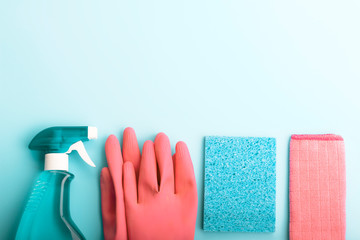 Cleaning products, gloves and rags on blue background with copy space, Spring cleaning concert
