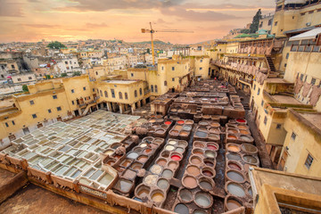 Poster Maroc Old tanks of the Fez's tanneries with color paint for leather. the Chouara Tannery is the oldest still working dates from 11th century. in the heart of the medina of Fes, Morocco at sunset.