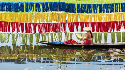 Handcrafted colorful lotus fabrics made from lotus fibers in Inle Lake, Shan State in Myanmar. These Inle handcrafted lotus fabrics are made using natural dyes and dried under sunlight.