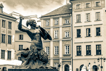 Sculpture in the old town in Warsaw. Old retro vintage style photo.