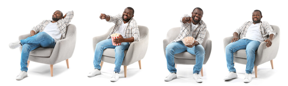 African-American man relaxing in armchair against white background