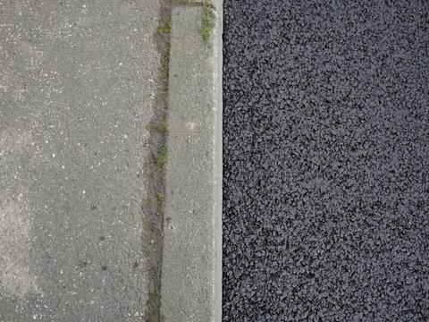 Straßenrand frischer Asphalt Bürgersteig