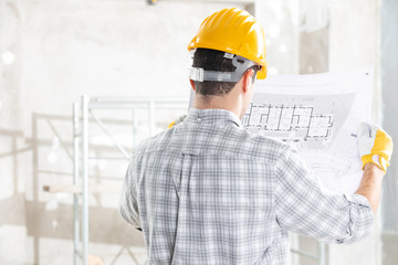 Architect or structural engineer with blueprint