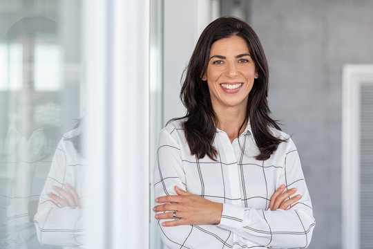 Successful mature business woman looking at camera