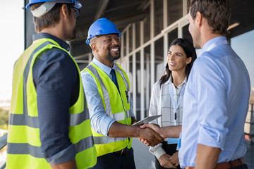 Engineer and businessman handshake at construction site