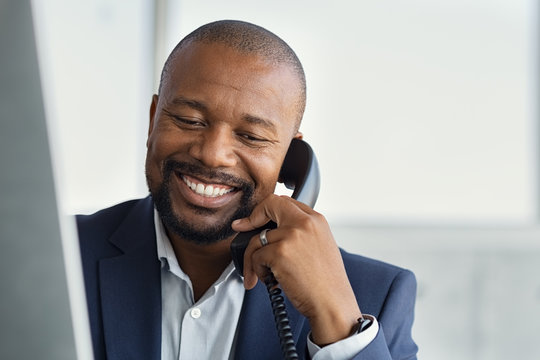 Mature black business man talking on phone