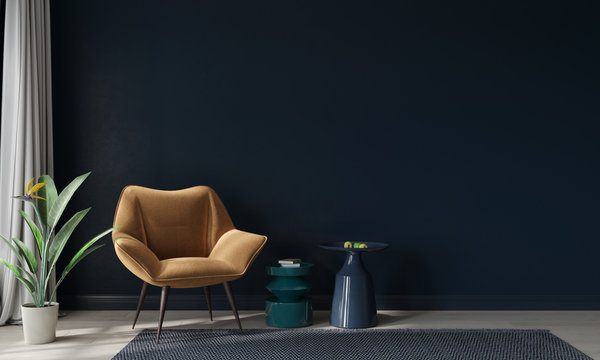 Mustard armchair and colored tables against a dark blue wall