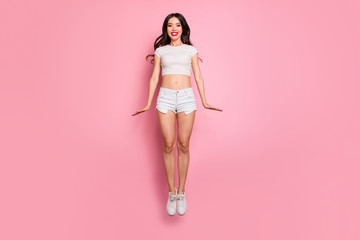 Full length body size view of her she nice attractive lovely charming slender thin cheerful funky cheery wavy-haired girl jumping up having fun isolated over pink pastel color background