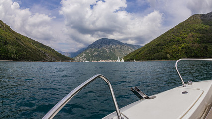 A swim in the Kotor bay of the Adriatic Sea in Montenegro on a tourist boat