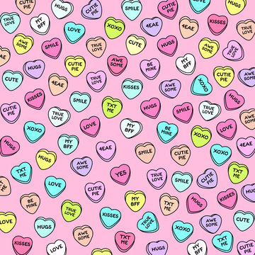 Colorful heart candy on pink background. Set of conversation sweets for valentine's day.