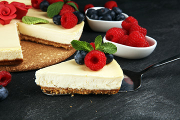 Homemade cheesecake with fresh raspberries and mint for valentines day - healthy organic summer...