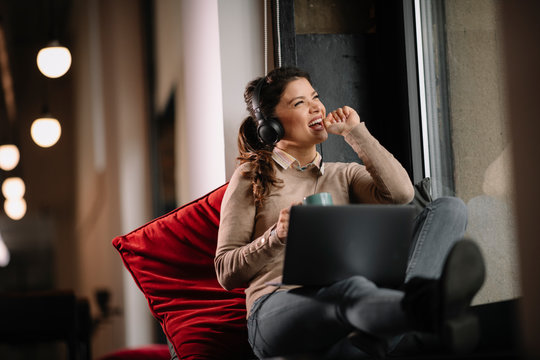 Young woman singing while working.
