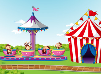 Foto op Canvas Kids Scene with monkeys on circus ride and tent in the park