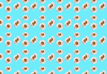 Cup of espresso coffee flat lay creative broken pattern on blue pastel color background. Pop art design concept.