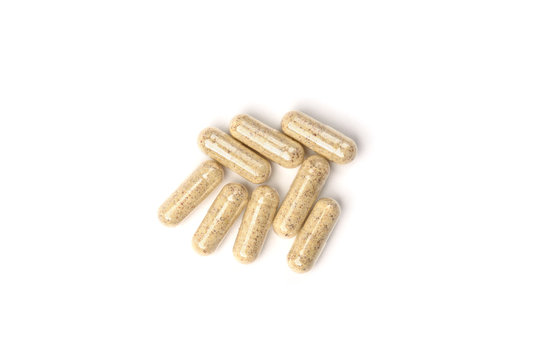 Herbal capsules isolated on white background.