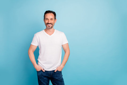 Portrait of his he nice attractive cheerful cheery glad content brunette guy wearing casual look clothes isolated on bright vivid shine vibrant teal green blue turquoise color background