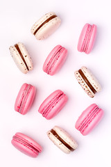Printed kitchen splashbacks Macarons Pink Strawberry and White Caramel and Salt Macarons French Delicate Dessert Pink and White Pastel Macarons Vertical Flat Lay