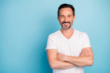 Portrait of his he nice attractive cheerful cheery glad content mature guy self-employed freelancer folded arms isolated over bright vivid shine vibrant teal green blue turquoise color background Wall mural