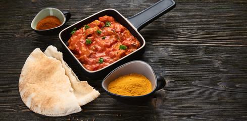 Wall Mural - Chicken tikka masala. Traditional indian cuisine.