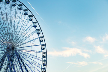 beautiful blue and white ferris wheel among the clouds