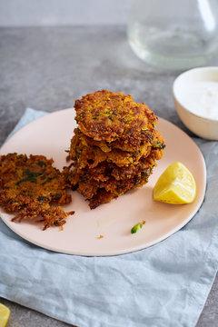 Potato latkes with lemon and yoghurt. Traditional israeli festive cuisine.