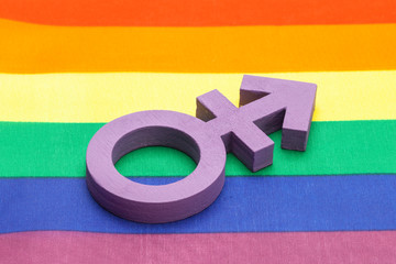 Violet transgender symbol on the background of the rainbow flag of the LGBT pride