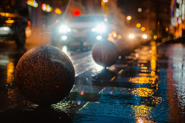 Wet night city street rain Bokeh reflection bright colorful lights puddles sidewalk Car