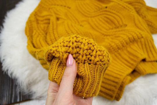 Bright yellow sweater closeup