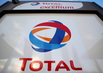 The logo of French oil giant Total is pictured at a petrol station in Laplume