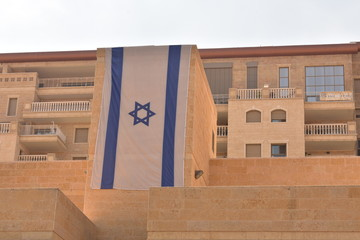 Israeli flag on stone building in Jerusalem