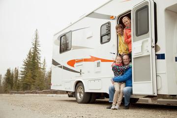 family portrait at camper doorway