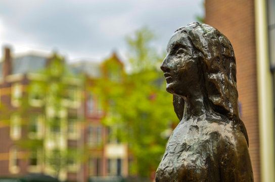 Amsterdam, Holland, August 2019. The statue of Anne Frank is a destination for many tourists: many pose for a souvenir photo with her. Here close-up image on the face of the statue.