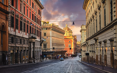 Rome, Italy. Deserted evening street of old town with road of paving stones and high houses. Picturesque landscape with sunset sky. Fotomurales