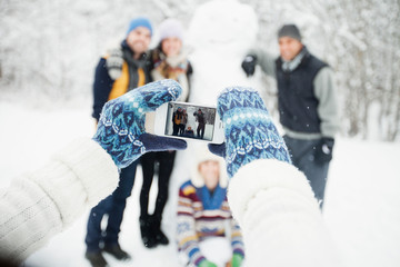 Picture taking with snowman