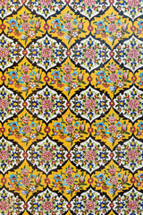 Yellow ceramic tile decorations in floral patterns with Islamic Iranian art