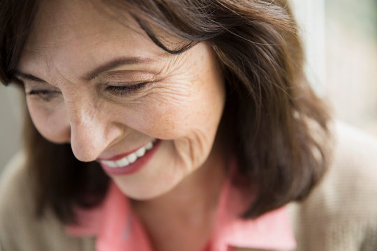 Close up of smiling woman looking down