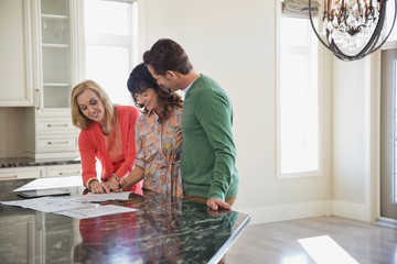 Female realtor discussing documents with couple